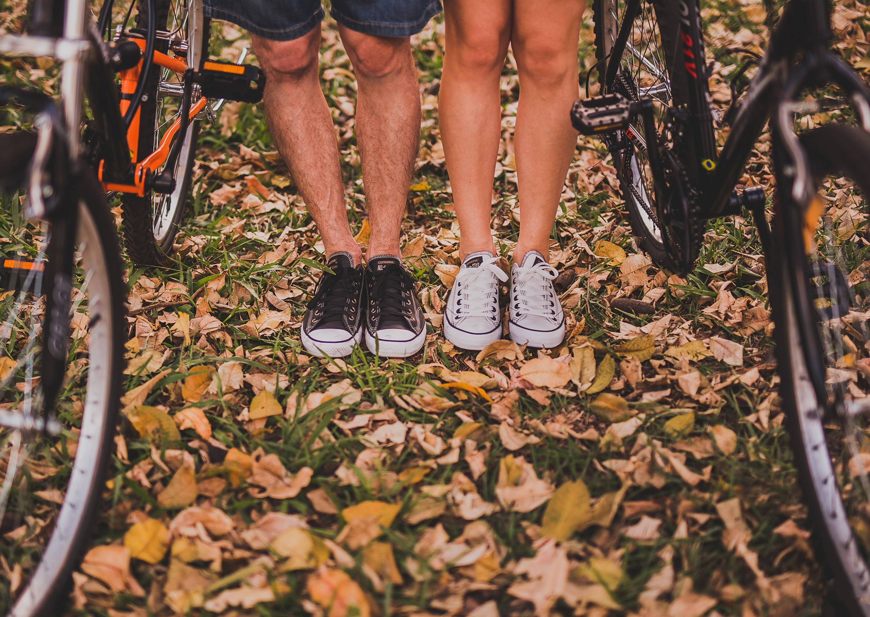 Image of a man a woman's legs with bicycles