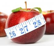 Image of an apple and measuring tape