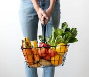 Image of a woman holding a basket of vegetables